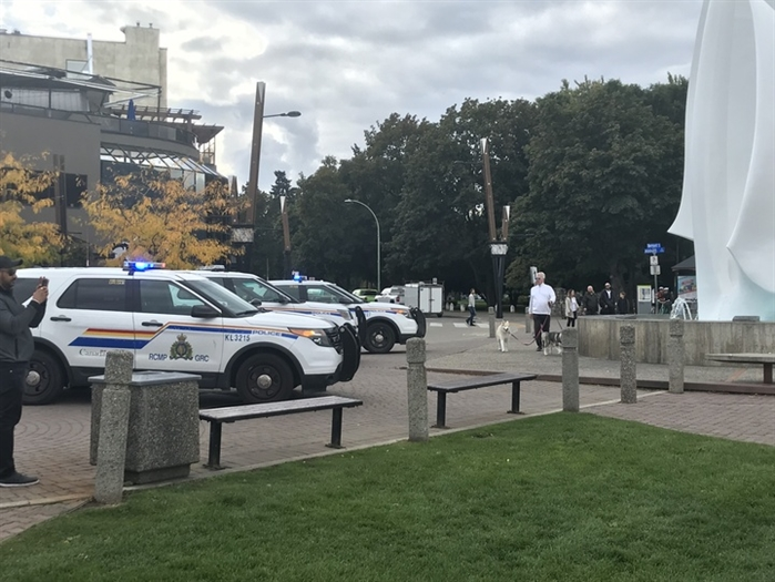 RCMP officers respond to reports of a man waving a hunting knife on the waterfront in downtown Kelowna, Friday, Oct. 4, 2019.