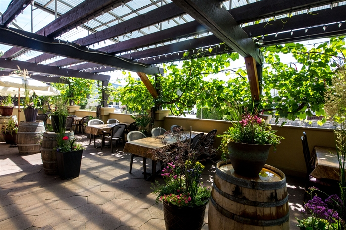 The patio at Villa Rosa creates an amazing Tuscan vibe for diners