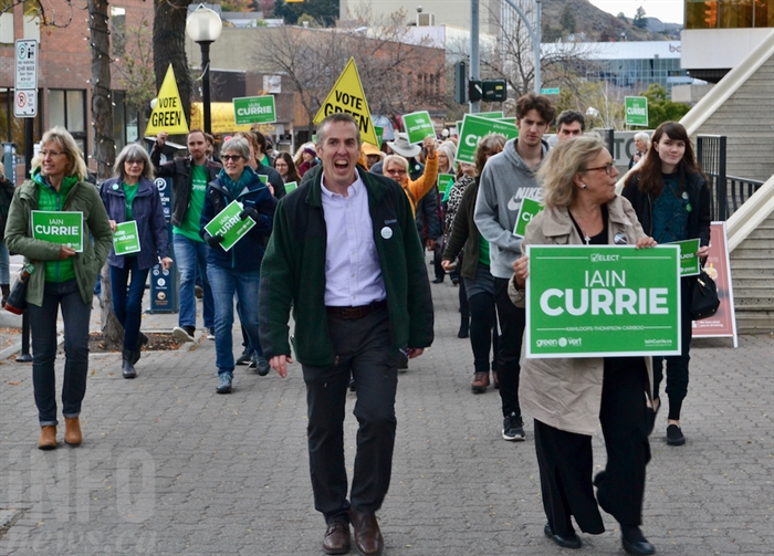 Kamloops-Thompson-Cariboo Green Party candidate Iain Currie, left, and leader Elizabeth May marched with a group of supporters through downtown Kamloops during a campaign stop, Tuesday, Oct.15, 2019.