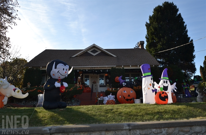 The vampire and the two ghosts are of the brand new inflatable decorations that were left anonymously for the Edwards'.