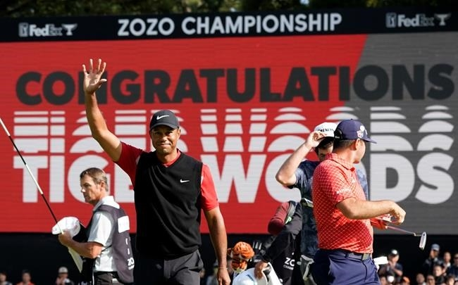 Tiger Woods of the United States celebrates after winning the Zozo Championship PGA Tour at the Accordia Golf Narashino country club in Inzai, east of Tokyo, Japan, Monday, Oct. 28, 2019.