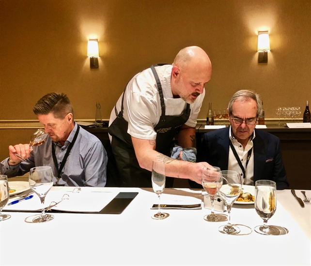 Chef Jeff Van Geest serves judges Chef Bernard Casavant (L) and national head judge James Chatto.