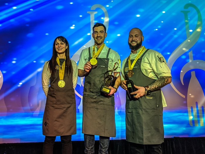 The chef medalists on stage (l-r) Chef Andrea Callan (Silver), Chef Kai Koroll (Gold), Chef Chris Braun (Bronze)