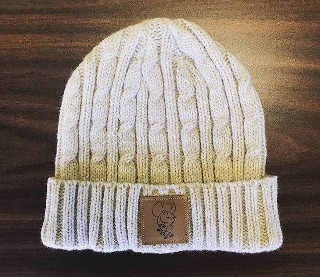 One of the three versions of Kami the Fish toques on sale for a limited time only.