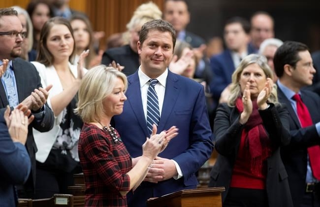 Leader of the Opposition Andrew Scheer is applauded by caucus members as he announces he will step down as leader of the Conservatives, Thursday, December 12, 2019, in the House of Commons in Ottawa.