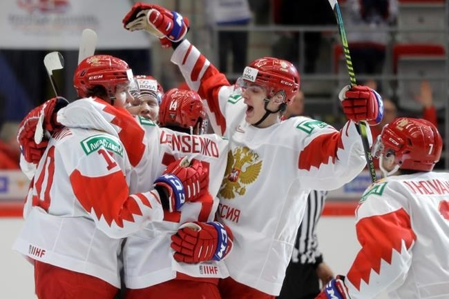Russia's Dmitri Voronkov, left, celebrates with teammates after scoring his sides first goal during the U20 Ice Hockey Worlds quarterfinal match between Switzerland and Russia in Trinec, Czech Republic, Thursday, Jan. 2, 2020.