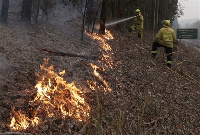 Firefighters manage a controlled burn to help contain a larger fire near Falls Creek, Australia, Sunday, Jan. 5, 2020. The deadly wildfires, which have been raging since September, have already burned about 5 million hectares (12.35 million acres) of land and destroyed more than 1,500 homes.