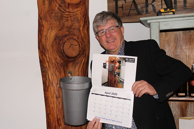 Roch Fortin a.k.a. Mr. April, (shown), with a copy of the Summerland Golden Jets calendar.