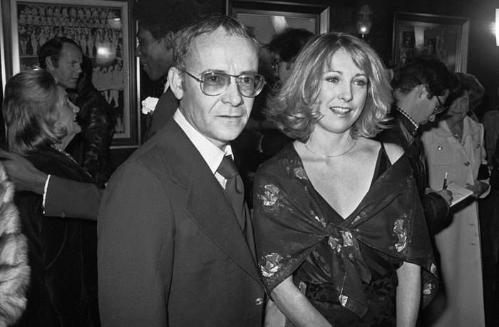 FILE - In this Nov. 15, 1977, file photo, Buck Henry and Teri Garr appear at the opening of the movie