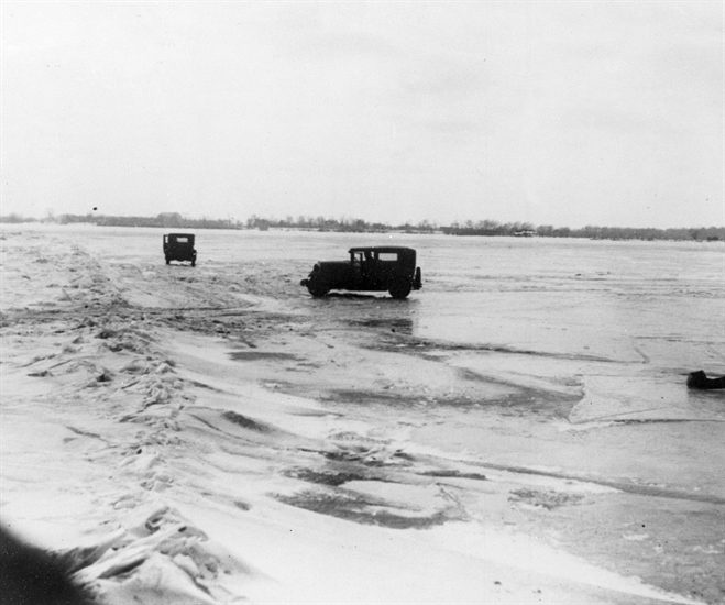 FILE - In this Feb. 14, 1930, file photo large quantities of Canadian beer and whisky are being transported in cars from Amherstburg, Ont., Canada, across the frozen lower Detroit River, to the Michigan side of the international boundary line. The cars are driven with one door open, so if the car goes through the ice the driver can scramble free.