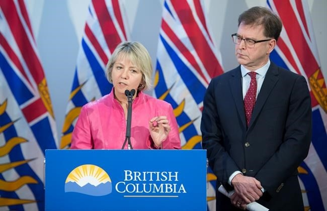 British Columbia Health Minister Adrian Dix looks on as Provincial Health Officer Dr. Bonnie Henry addresses the media during a news conference at the BC Centre of Disease Control in Vancouver B.C, Tuesday, January 28, 2020. Dix and Dr. Henry announced Tuesday that British Columbia has confirmed its first case of coronavirus and the person in question is being treated.