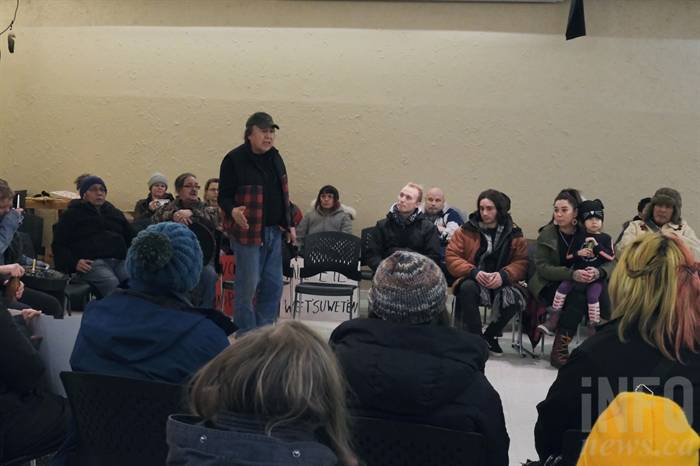 Dixon Terbasket addresses a crowd of roughly 100 people who gathered at the Ki-Low-Na Friendship Society Sunday to show support for the Wet'suwet'en.