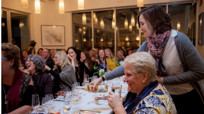 Winemaker Severine Pinte from La Stella Winery pouring at last year's dinner event.