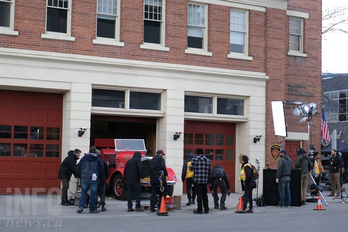 A film crew is seen working on the TV movie