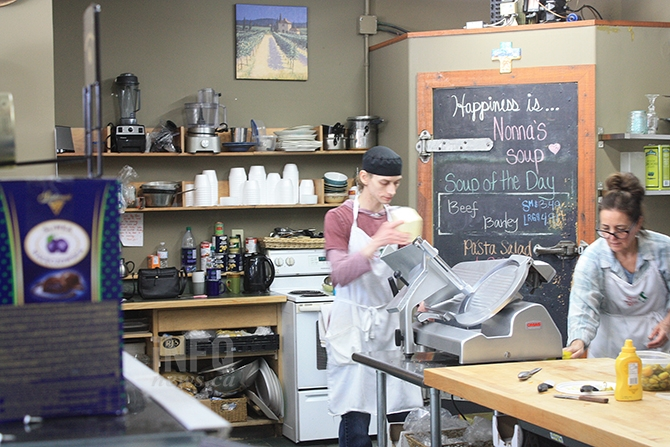 Il Vecchio Delicatessen employees Sandy Montle and Susan Rempel prepare for the next wave of customers.
