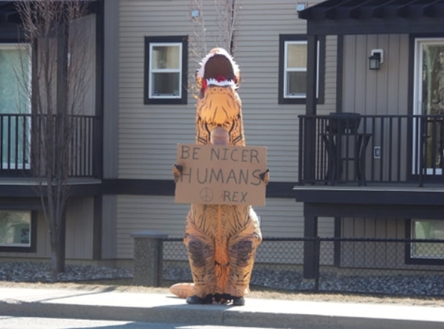 The dinosaur switched signs to encourage humans to be nicer.