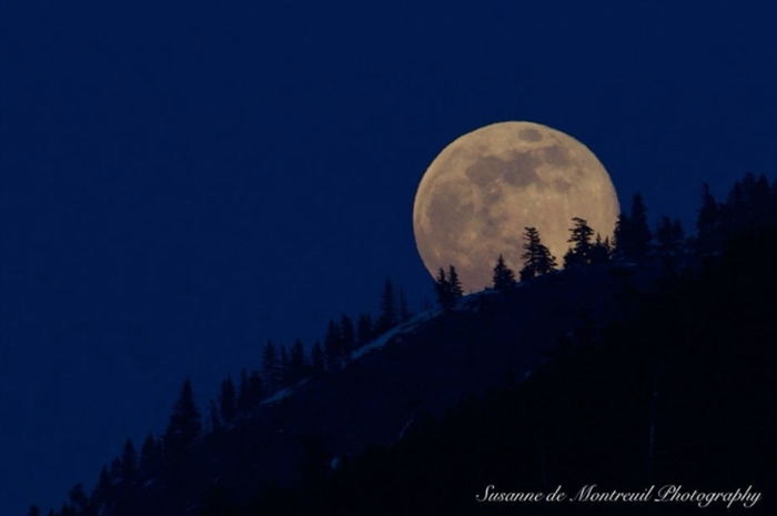 This photo was captured as the moon rose in Kamloops.