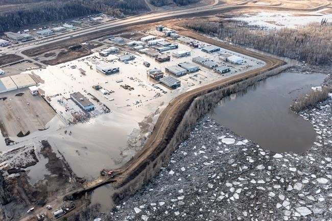 The flooded Taiga Nova Eco-Industrial Park alongside the Athabasca River at the north end of Fort McMurray is shown on Tuesday, April 28, 2020. Officials in Fort McMurray are keeping a close eye on river levels after a 25-kilometre ice jam caused major flooding and forced about 12,000 people from their homes.