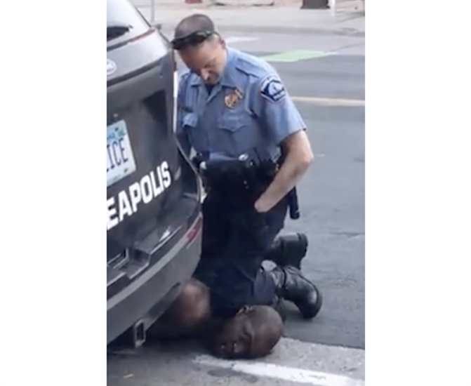 In this Monday, May 25, 2020, frame from video provided by Darnella Frazier, a Minneapolis officer kneels on the neck of a handcuffed man who was pleading that he could not breathe in Minneapolis. Four Minneapolis officers involved in the arrest of a George Floyd who died in police custody were fired Tuesday.