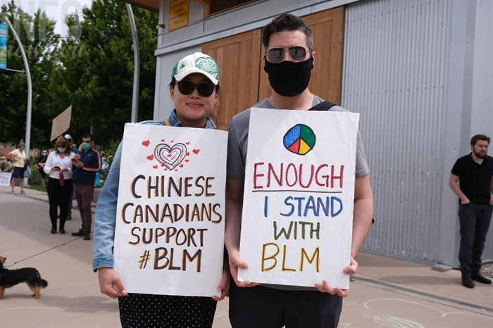 Winni and Cameron McIntosh created signs to show their support for the Black Lives Matter movement during a protest in Kelowna, June 5.