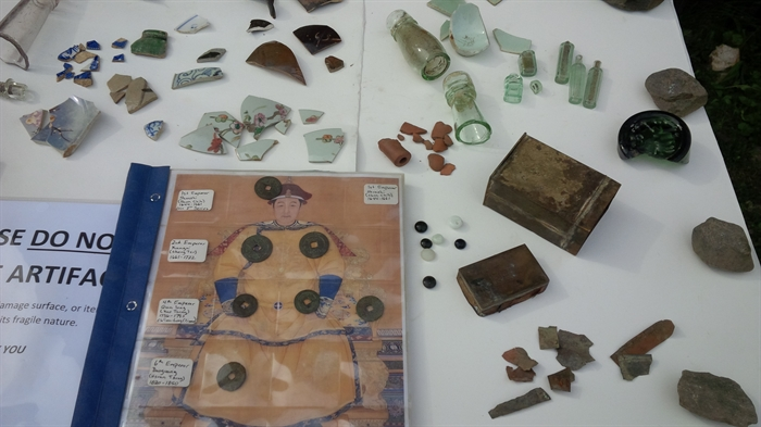 Some of the items uncovered in an early Chinese restaurant garbage pit in Barkerville include Chinese pottery, medicine bottles, fan tan beads, opium tin and fragments , pipe fragments and Chinese coins in binder.