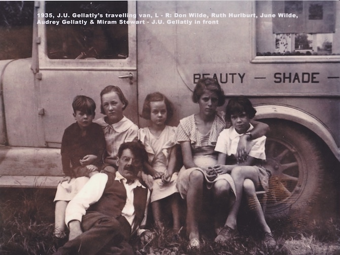 Jack Gellatly in front with family members with his nut van in back depicting his slogan, Beauty, Shade and Profit.
