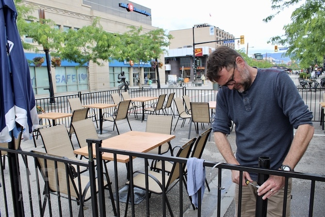 FILE PHOTO - Louis Drummond puts the final touches on his Fernando's Pub patio.