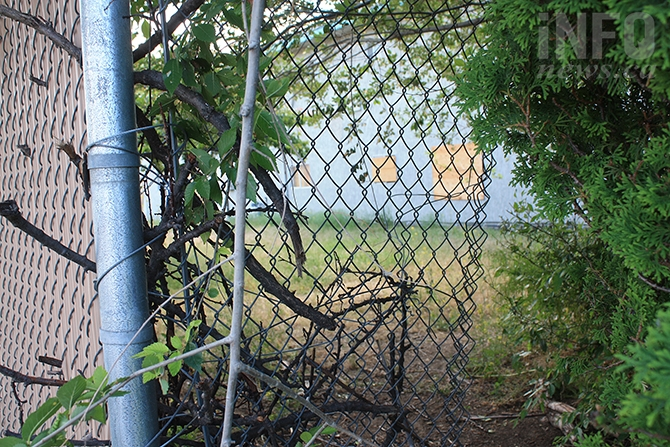 Business owners adjacent the Compass House facility say there are numerous gaps in the chain link fence surrounding the property as well as a general lack of security.