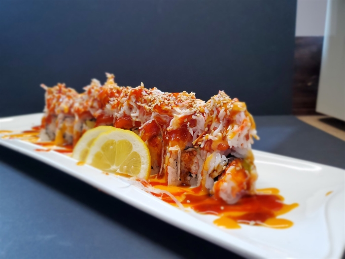 Blue Fish Sushi's Mountain roll, with salmon and spicy crab on top of a California roll.