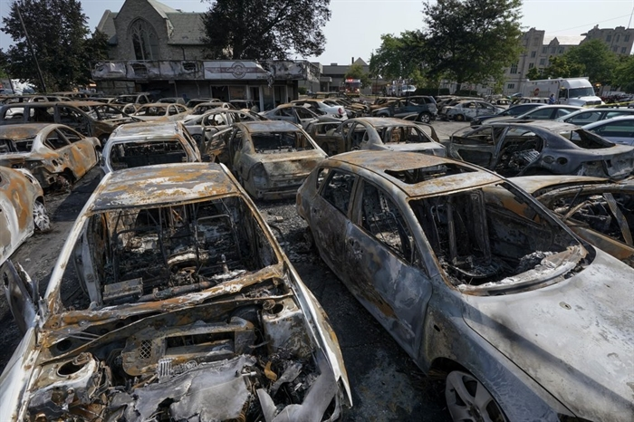 Burned out vehicles are seen Monday, Aug. 24, 2020, in Kenosha, Wis. Many of the cars were set on fire during protests Sunday night after a police shooting in the city.