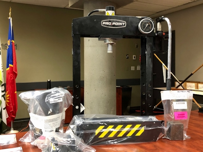 A drug brick press is seen among other items seized by Surrey RCMP, Aug. 20. 2020.