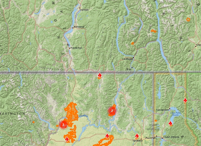 The Customs Road wildfire (shown in flame symbol near the border) is burning 12 km from the B.C. village of Midway.