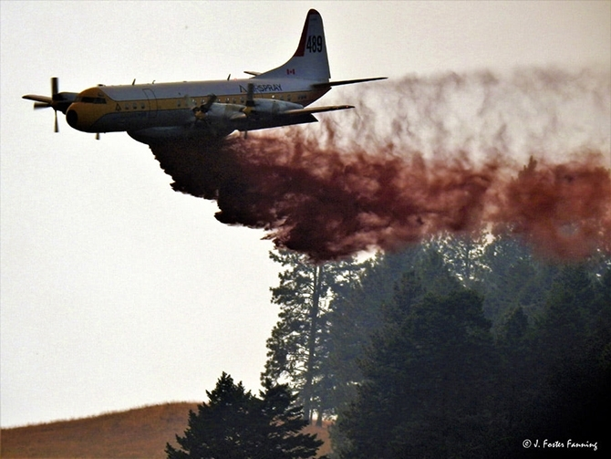A B.C. wildfire air tanker working the Customs Road wildfire in Washington earlier this week. The air tanker came to the rescue of Ferry County residents Boddy and Cindy Poirer, saving their cabin from the flames.