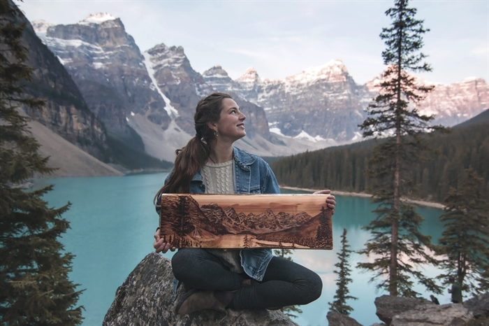 Kelowna-based artist Samm Moore at Moraine Lake.