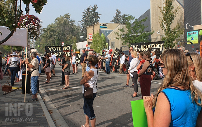 A crowd of around 100 people gathered to oppose a proposed 350 unit subdivision near Campbell Mountain in Penticton.