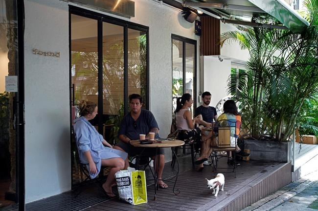 Customers sit in at tables outside the Found Cafe in Hong Kong on Sept. 13, 2020. Cannabis, also known as marijuana, in Hong Kong may be illegal, but the new Found Cafe is offering a range of food and drinks that contain parts of the cannabis plant without breaking any local laws.