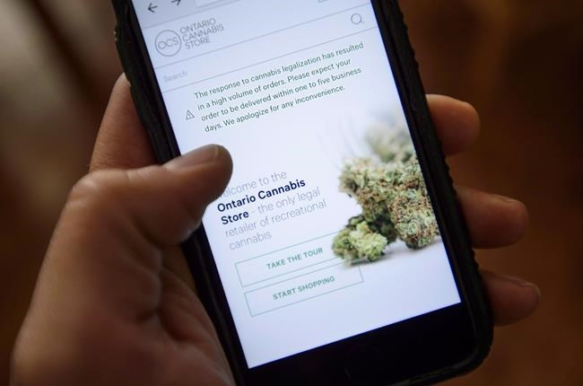 A Ontario Cannabis Store website pictured on a mobile phone Ottawa on Thursday, Oct. 18, 2018. The Ontario Cannabis Store says Thomas Haig has been appointed its interim president and chief executive.
