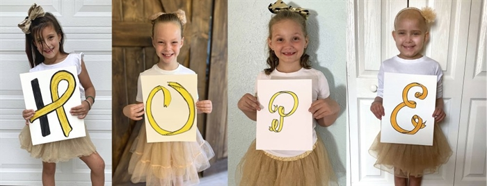 This photo combo provided by the Johns Hopkins All Children's Hospital shows Chloe Grimes, McKinley Moore, Avalynn Luciano and Lauren Glynn spelling the word