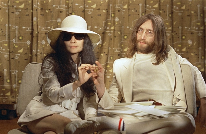 This 1969 photo shows musician John Lennon, right, and his wife Yoko Ono during a press conference. An album,