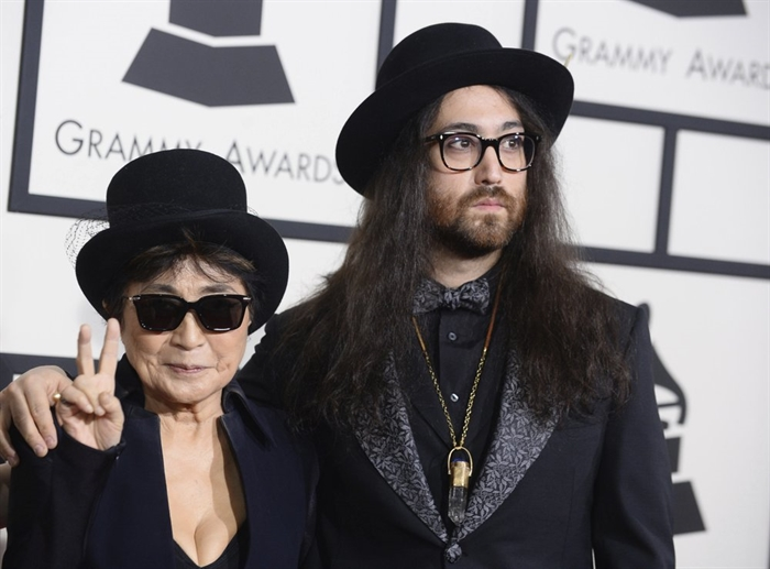 FILE - Yoko Ono, wife of the late John Lennon, left, and their son Sean Lennon arrive at the 56th annual Grammy Awards in Los Angeles on Jan. 26, 2014. An album,