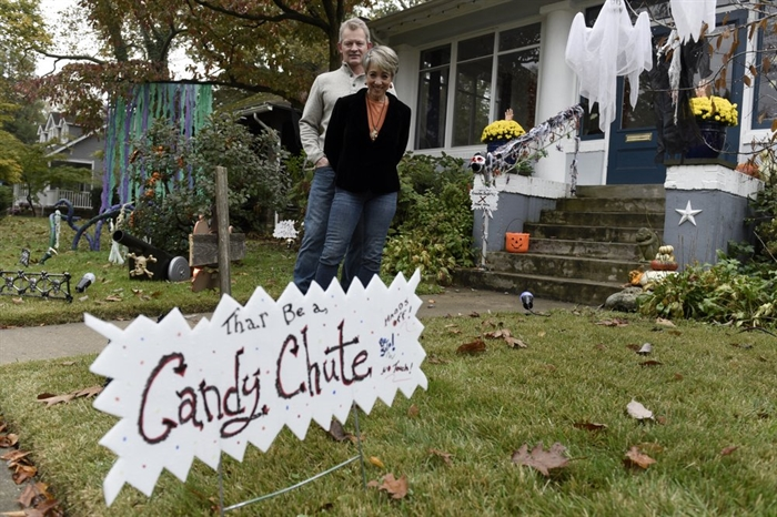 Carol McCarthy and her husband, Tom, pose for a portrait at their home they decorated for Halloween, Monday, Oct. 26, 2020, in Palmyra, N.J.