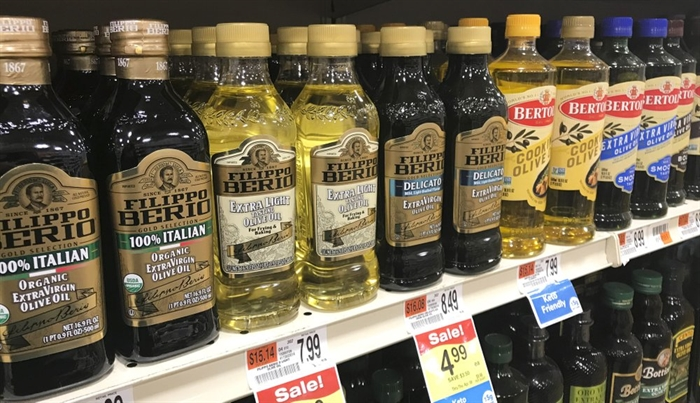 A variety of olive oils are displayed at a grocery store in Waterbury, Vt. on March 26, 2021.