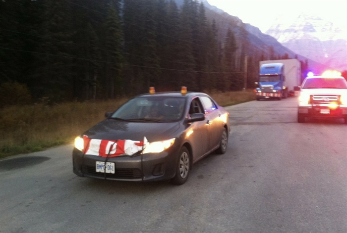 The pilot car escorting an oversized load was stopped because it didn't have the property roof-mounted illuminated sign board and the sign on the front of the care was also wrong.