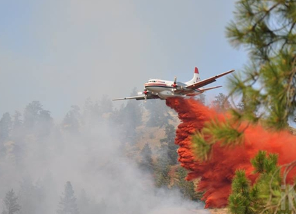 An air tanker drops fire retardant on a wildfire in West Kelowna.