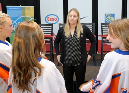 Team Canada hockey player Haley Irwin visits with minor hockey players in Kamloops earlier this year.