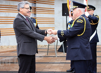 Minister of Public Safety and Solicitor General Mike Morris hands over the keys to the new Okanagan Correctional Centre to Warden Steve DiCastri today, Oct. 21, 2016.