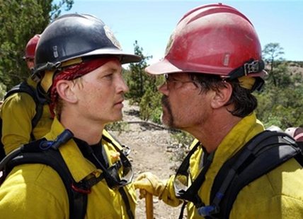 "This image released by Sony Pictures shows Miles Teller, left, and Josh Brolin in a scene from ""Only the Brave."""