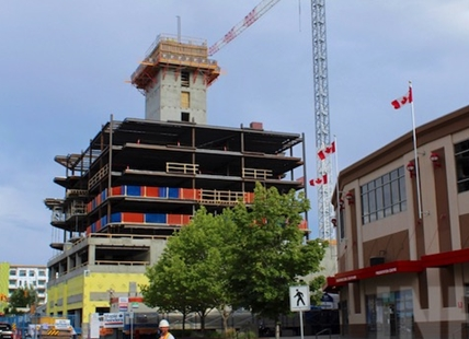 Once on the fringes of downtown, Prospera Place is the centre of a high-rise and cultural district in Kelowna - including a new tower, shown here, being built by the arena operators R.G. Properties (now the GSL Group).