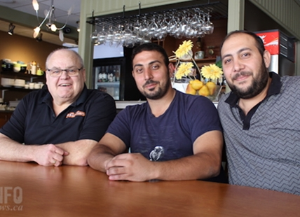 Papa G's Cafe owner Gerald Thiessen, left, has sold his Seymour Street location in Kamloops to brothers Rojeh, middle, and Robert Labbad who will be opening a new Arabic restaurant in the upcoming weeks.