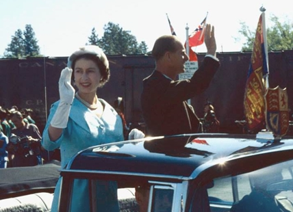 Queen Elizabeth and Prince Philip riding in a convertible through Vernon, B.C. circa 1959. They went on to stay at the Pennask Lake Lodge after this appearance in Vernon.